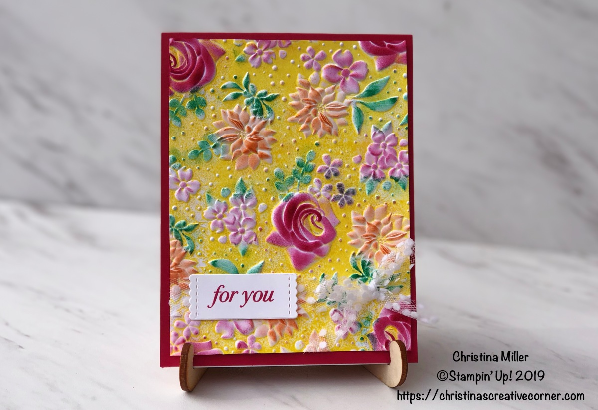 Create a colorful background with Country Floral Dynamic Textured Impressions Embossing Folder
